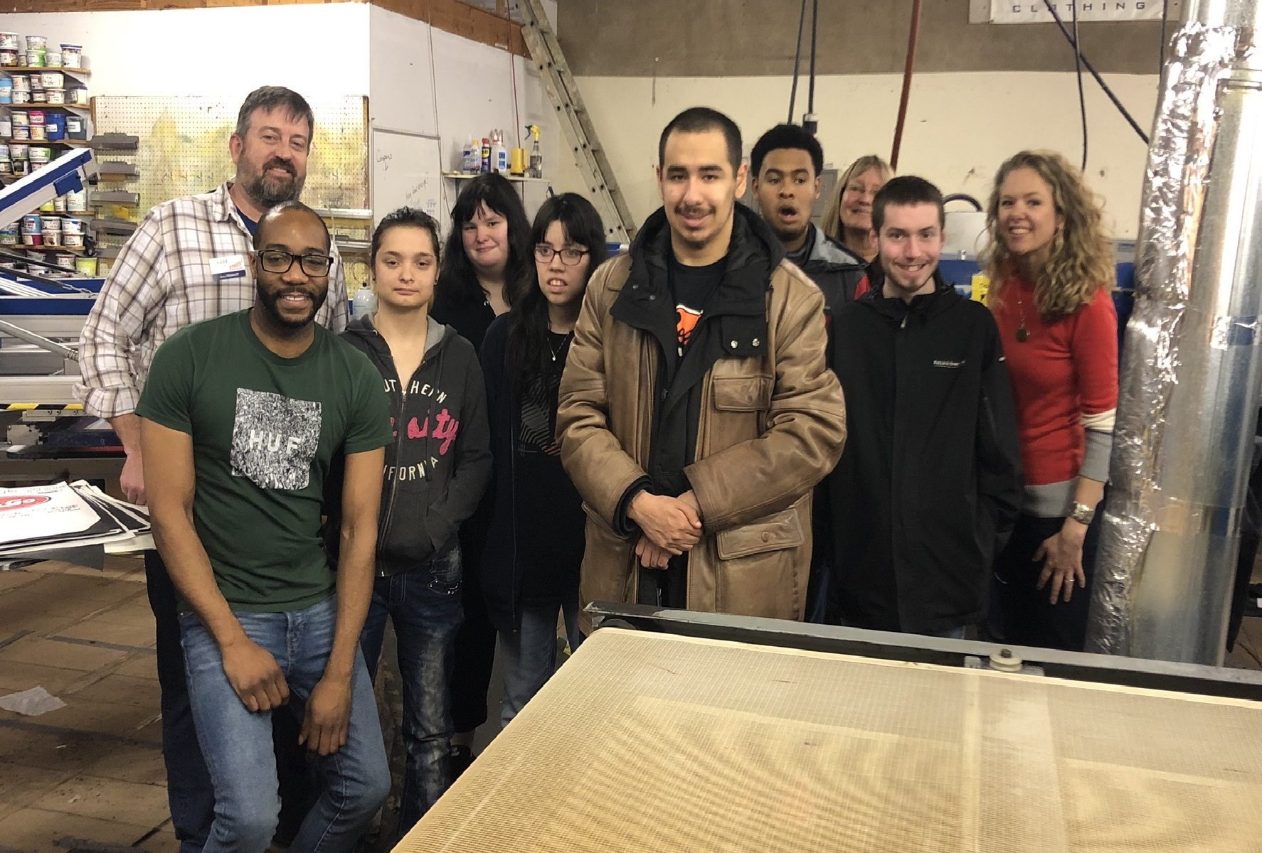 A group of eight Centennial CTP students and staff standing with Gary Chiaravalli of DCC and Michal of Righteous Clothing.